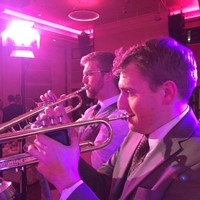 Function band trumpeters performing at a charity ball in London