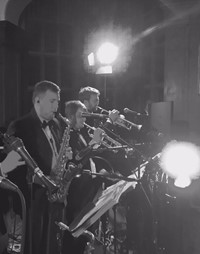 Live band performing for a wedding reception at Selwyn College, Cambridge - saxophone and trumpet
