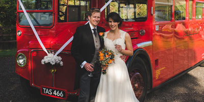 Bride and groom with London Routemaster bus