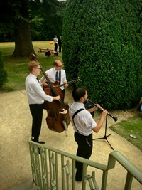 Acoustic jazz trio performing live roaming walkabout music for a wedding reception in Gloucestershire