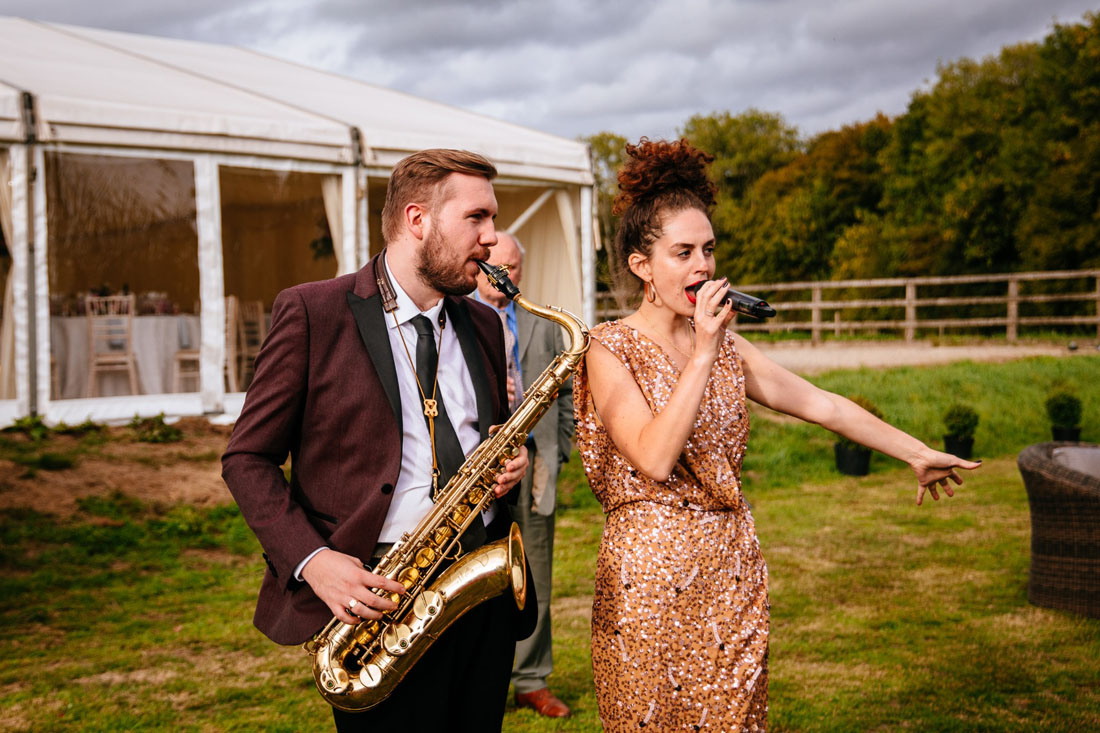 Roaming acoustic wedding band featuring female vocalist and tenor saxophonist