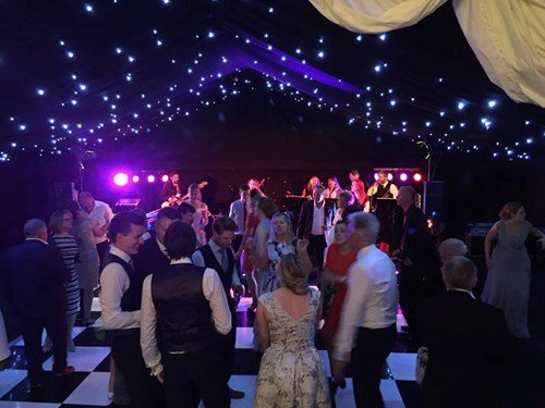 Live wedding band performing dancing music at Creslow Manor, Buckinghamshire