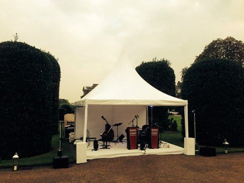 Jazz band ready to perform at Kensington Palace Gardens, London