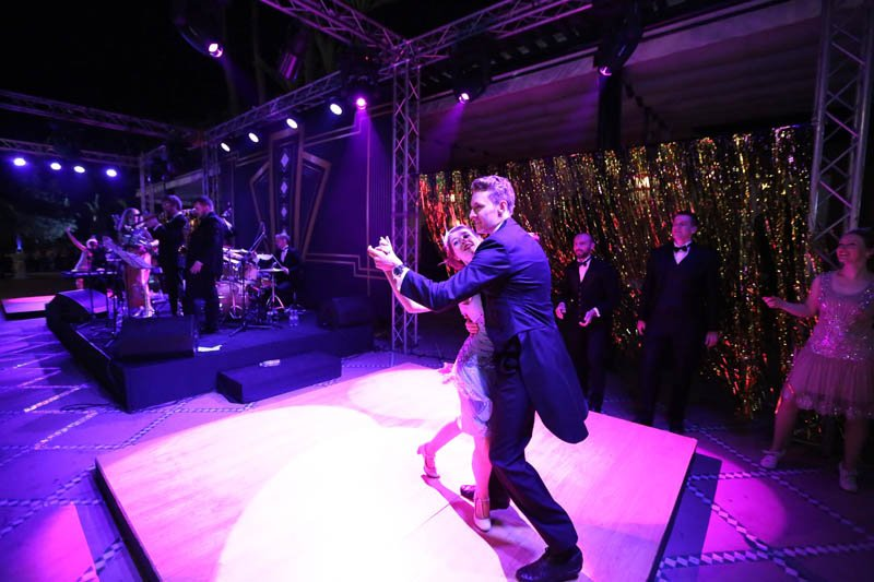 Vintage swing and lindy hop dancers performing at a corporate event with live music in Marrakesh, Morocco