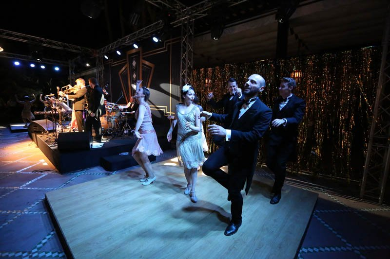 Vintage swing and lindy hop dancers performing a solo routine at a corporate event with live music in Marrakesh, Morocco