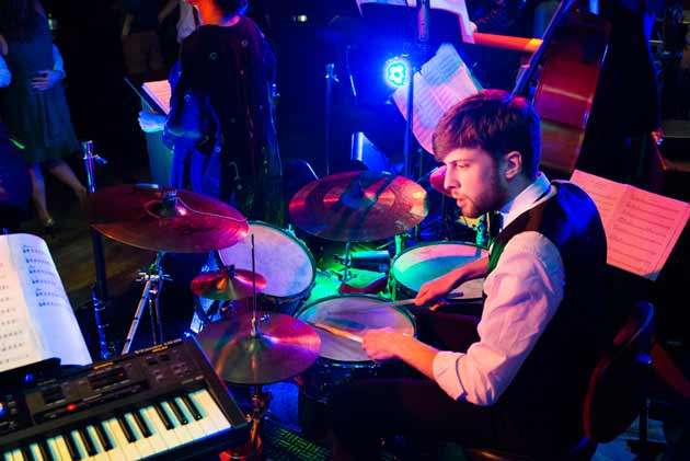 Drummer performing live music with party band on New Year's Eve in London