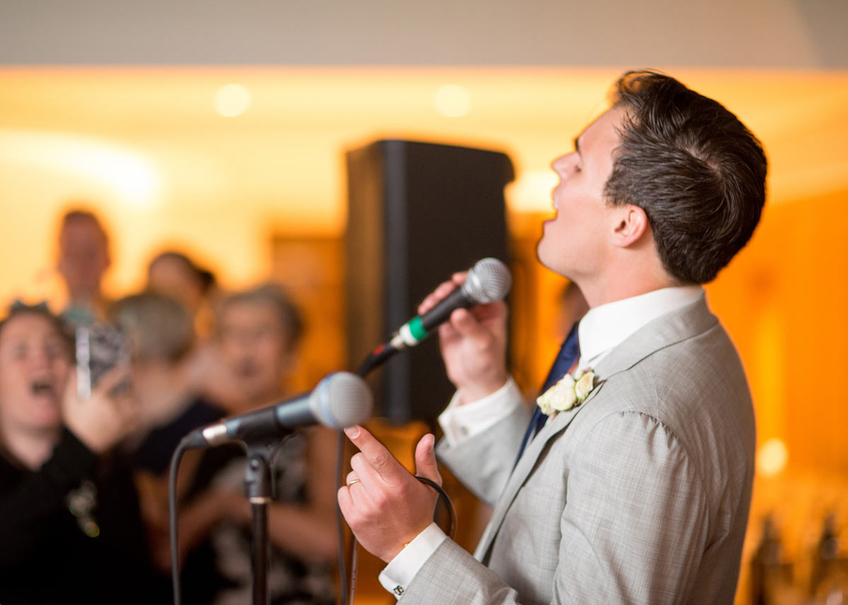 Groom performing with the live wedding swing band at Le Manoir aux Quat'Saisons, Oxfordshire
