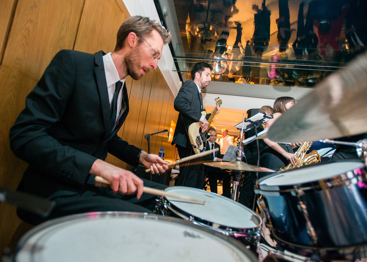 Drummer performing with a live wedding swing band at Le Manoir aux Quat'Saisons, Oxfordshire