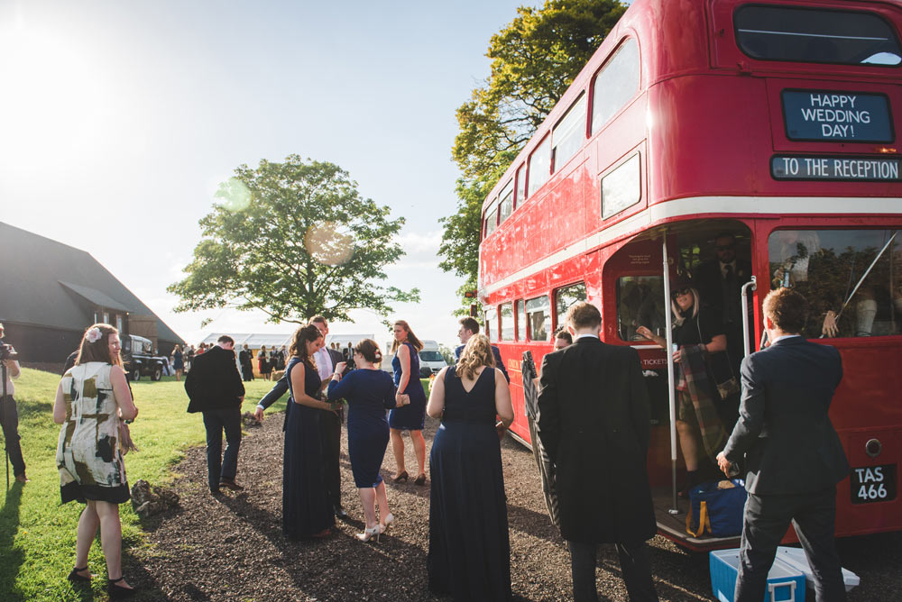 Guests arriving at Oxfordshire wedding in a London Routemaster bus