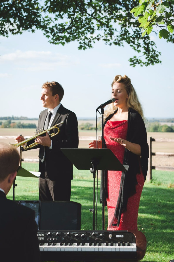 Jazz trio performing outside at an Oxfordshire wedding reception
