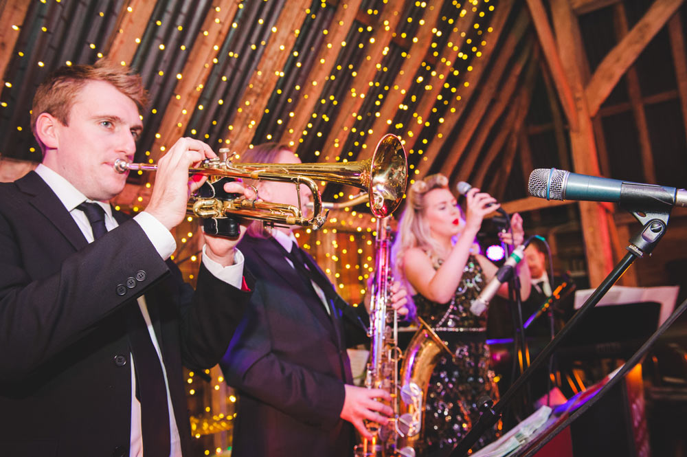 Live swing band performing at a wedding reception in Oxfordshire