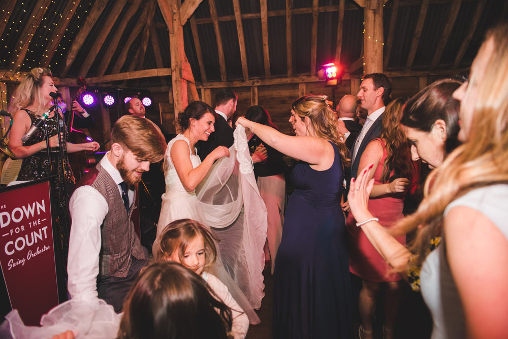 Guests dancing to live swing music at a wedding reception in Oxfordshire