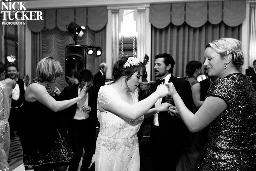 Dancing to live swing music at London wedding reception