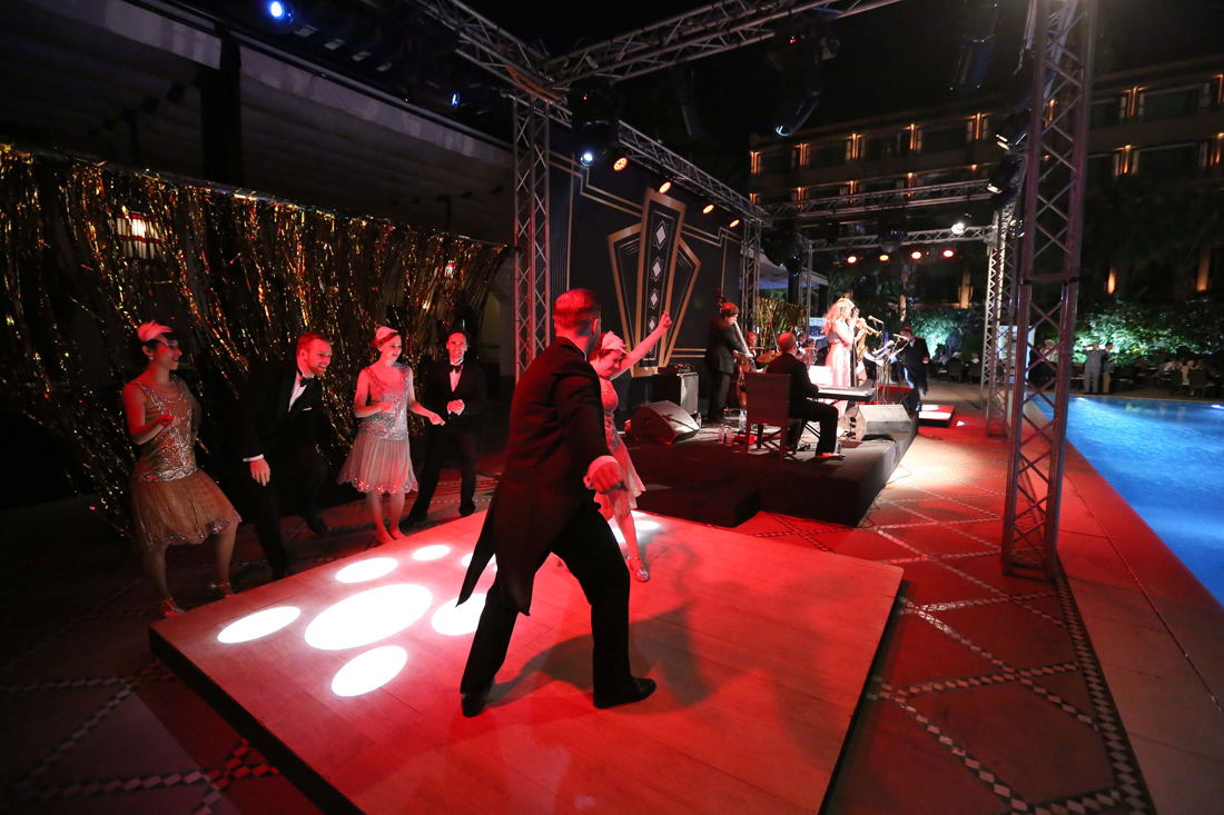 Entertainment ideas for Christmas party vintage swing collective 1920s and 1940s styled dancers taking fun taster dance lesson with live music