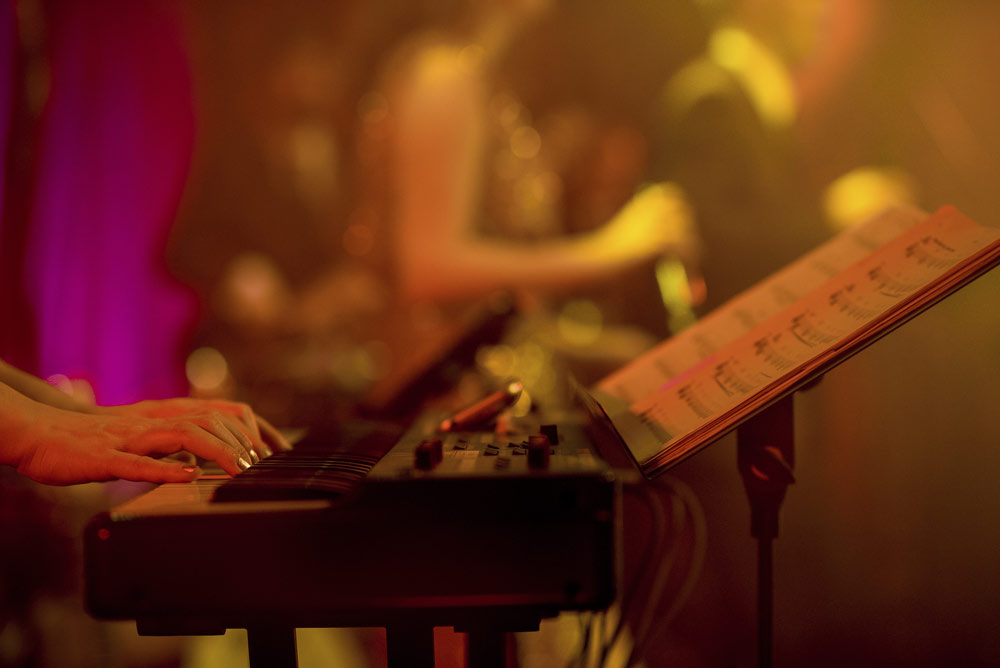 Keyboardist performing live music at London party
