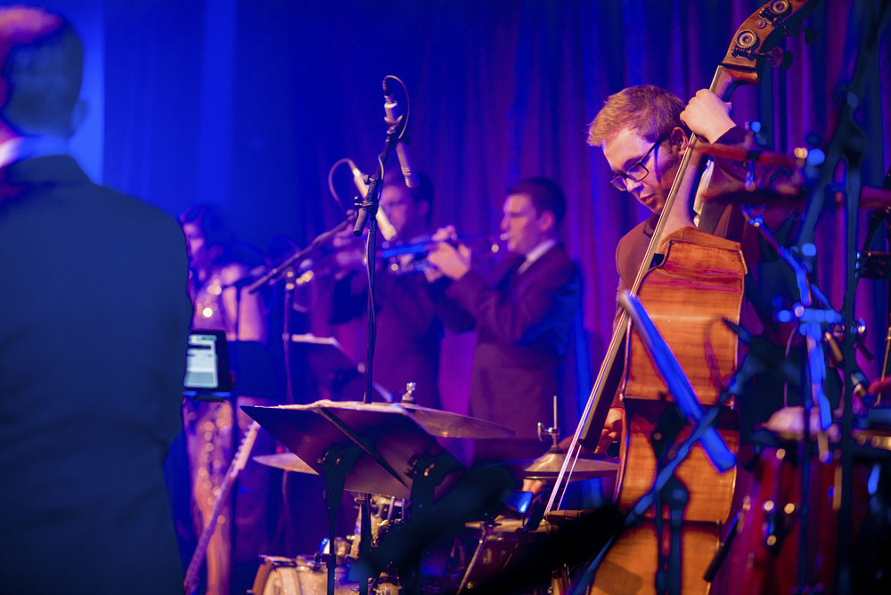 Upright bassist performing live swing music at London event