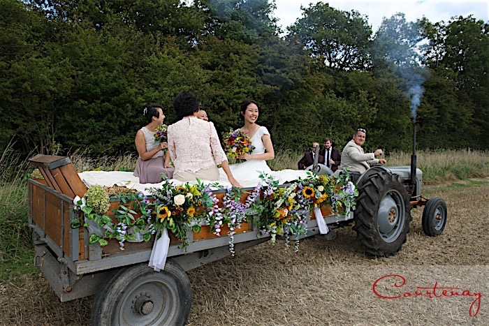 Countryside wedding ceremony on vintage tractor